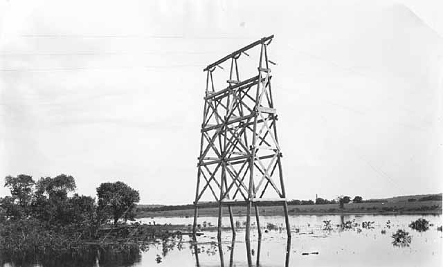 Electric power line tower, owned by Northern States Power Company, Bayport, 06/30/1920.