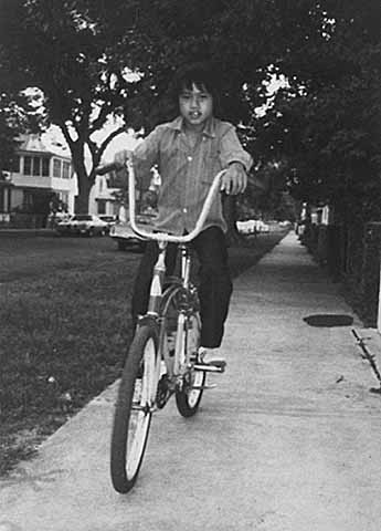 Seng Yang riding his first bicycle, St. Paul, 1980. MHS Photo Collection.