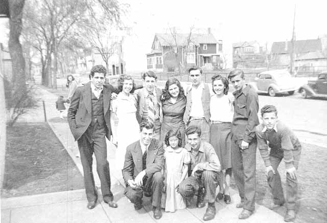 Group in front of Gust Sarrack residence, 647 Bedford, St. Paul.