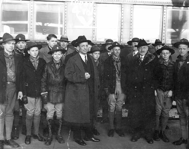 1932 photograph of U.S. Army Col. Theodore Roosevelt III, being greeted in St. Paul, Minnesota by a group of Boy Scouts.  Minnesota Historical Society collection.