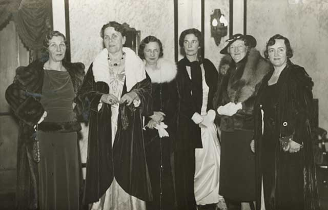 Women in evening gowns.
