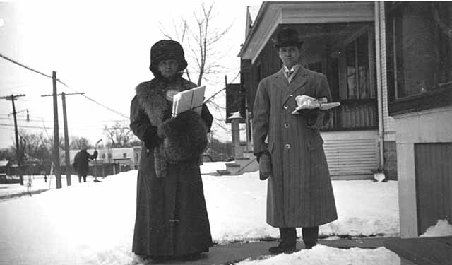 Anna and Louis Wommer delivering Christmas presents on Upton Avenue South, Minneapolis.