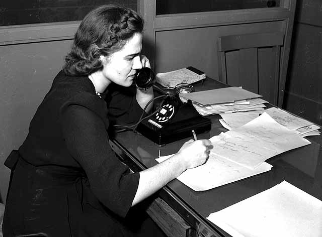 Violet Ventura, society writer for St. Paul Dispatch-Pioneer Press, at her desk.