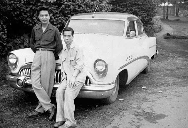Ying and Oct Huie with car, Duluth, ca. 1955. MHS Photo Collection.