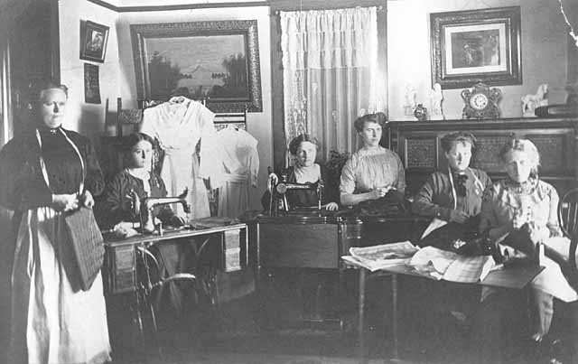 Teacher and pupils in seamstress course, Dawson.
