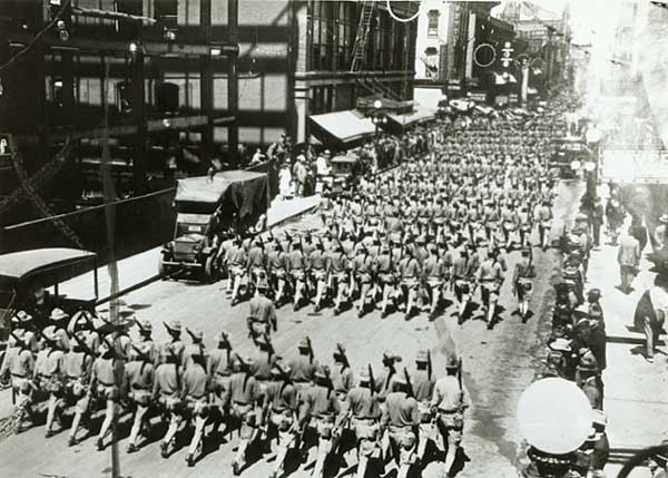 Company B, 36th Infantry, parading east on Sixth Street in St. Paul during the World War.