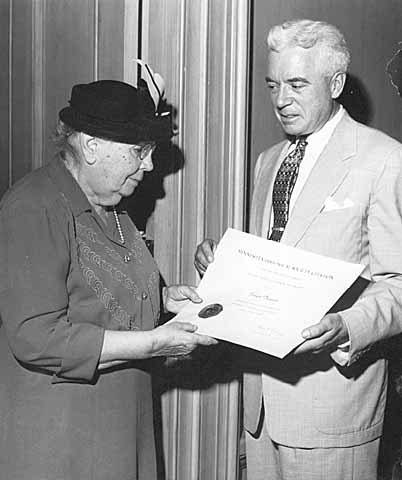 Frances Densmore being presented with the a citation from Harold Dean Cater (MHS Director), 10/1954