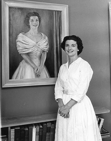 Jane Freeman with the painted portrait of herself, c. 1958