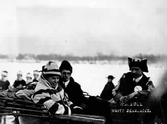 Unidentified men in automobile, possibly at the St. Paul Winter Carnival, St. Paul, Minnesota.