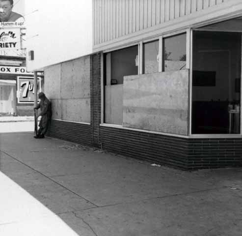 Storefronts boarded up along Plymouth Avenue during race riots, North Minneapolis.