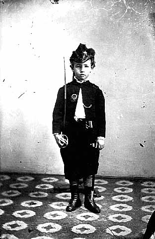 Boy in military uniform.