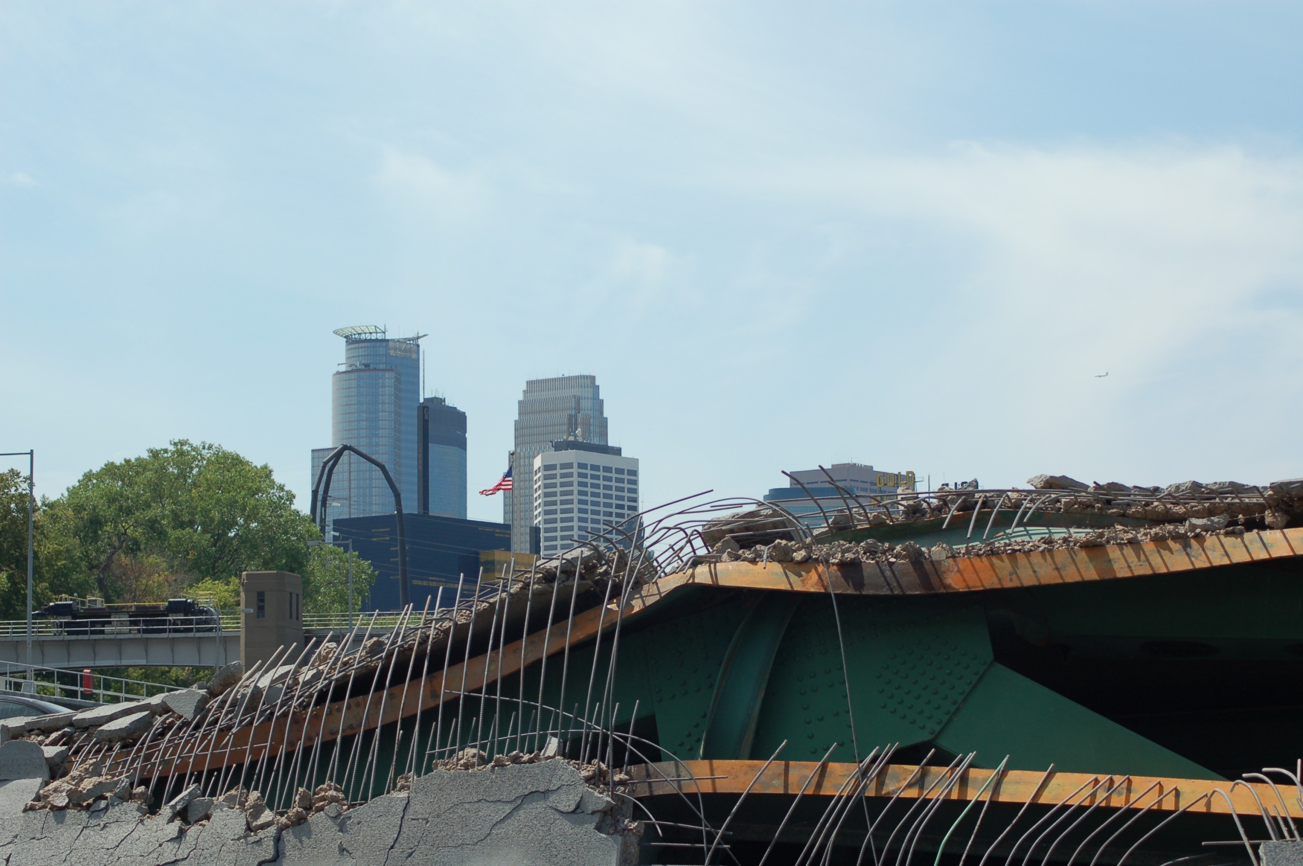 View of Interstate 35W bridge wreckage with downtown Minneapolis in the background