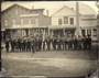 Company D, 1st Minnesota Regiment posed at the southeast corner of Nicollet Avenue and First Street, Minneapolis
