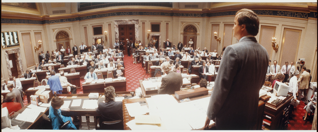 Members of the Minnesota House of Representatives meeting in the Senate Chambers, 1989.