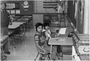 Pitaro Khouth and Mary Khouth listening to language tapes at Centennial School, Richfield, 1980. MHS Photo Collection.