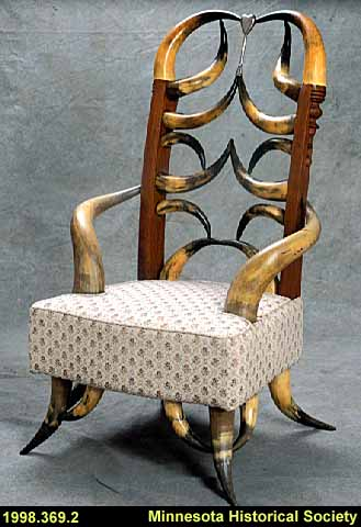 Upholstered oak and horn armchair